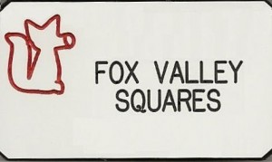 White badge with red fox and black letters