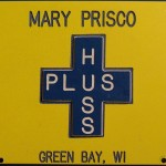 Yellow and blue Huss Plus badge