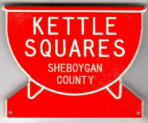 Red kettle-shaped badge with white lettering
